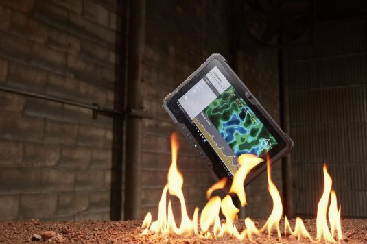 Latitude 12 7212 Rugged Tablet falling into dirt and fire.